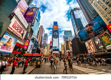 New York City - June 14, 2017: Busy Times Square in NYC. The place is famous as world's busiest place for pedestrians and an iconic landmark for thousands of tourists in Manhattan.