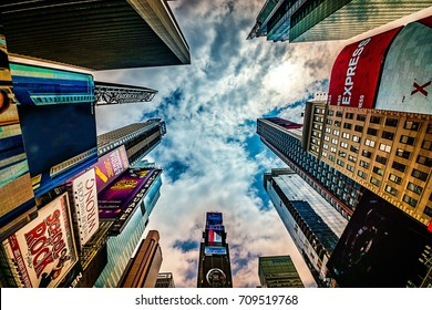 New York City - June 14, 2017: High rising skyscrapers at Times Square in NYC. The place is famous as world's busiest place for pedestrians and an iconic landmark in Manhattan, America.