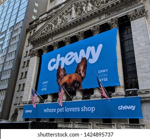 New York City, June 15, 2019: Banner on the New York Stock Exchange Building celebrating the IPO of the pet supply company Chewy in Lower Manhattan.