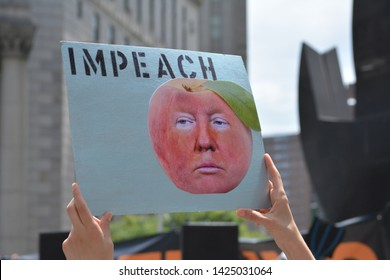 New York City, June 15, 2019: People at an Impeach Now rally against President Trump in Foley Square in Lower Manhattan.