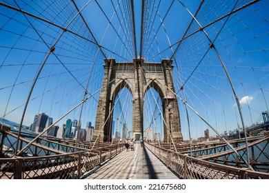 NEW YORK CITY - JUNE 16, 2014: The Brooklyn Bridge seen from its pedestrian walkaway. Approximately 4,000 pedestrians and 3,100 cyclists cross this historic bridge each day.