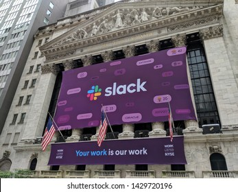 New York City - June 20, 2019: Banner on the New York Stock Exchange Building celebrating the IPO of the workplace chat platform Slack in Manhattan.