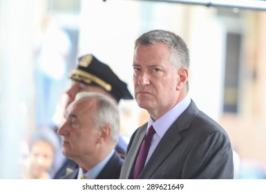NEW YORK CITY - JUNE 20 2015: Bill de Blasio, commissioner William Bratton & members of Rafael Ramos's family attended a ceremony renaming a street in Cypress Hill after the slain NYPD detective