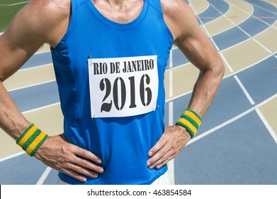 NEW YORK CITY - JUNE 20, 2016: Athlete wearing Rio de Janeiro 2016 race bib stands in front of running track in celebration of the city hosting the Summer Games.