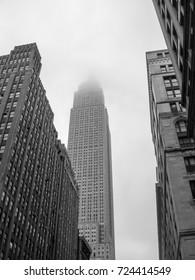 New York City - June 20, 2009: Empire State Building in New York City shrouded in fog (black and white).