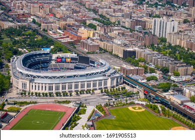 NEW YORK CITY - JUNE 2013: Yankee Stadium aerial view with city buildings.