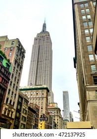 NEW YORK CITY - JUNE 2013: Empire State Building on a rainy day. New York attracts 50 million visitors every year.