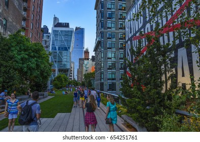 NEW YORK CITY - JUNE, 2016: The wonderful urban view from the High Line Park in Manhattan. The High Line is a popular linear park built on the elevated train tracks above Tenth Ave in New York City