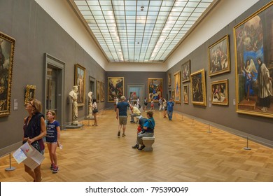 NEW YORK CITY - JUNE 2016: Lot of people and Tourists walk inside the Metropolitan Museum of Art, the largest art museum in the United States of America