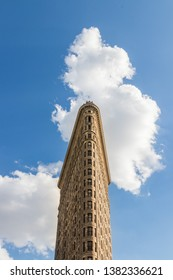 New York City - June 2017 : Flatiron Building ( Fuller Building) in Manhattan, New York City. It is a triangular steel-framed landmarked building located at Fifth Avenue