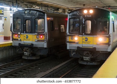 New York City - June 2017: Long Island Railroad LIRR trains sit in Penn Station - midtown Manhattan. Delayed train cause commute business people to wait for travel
