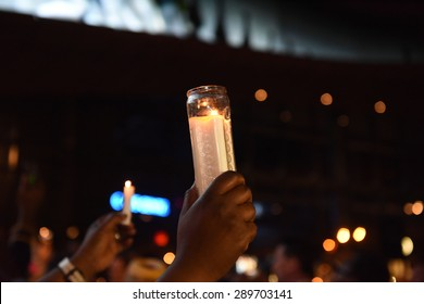 NEW YORK CITY - JUNE 21 2015: Brooklyn borough president Eric Adams hosted a candlelight vigil at the Barclay's Center on behalf of victims of the Emanuel A.M.E massacre. Candles held aloft.