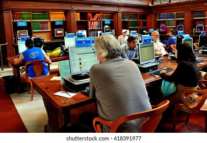 New York City - June 22, 2013:  People using the internet with public computers in a second floor reading room of the New York Public Library on Fifth Avenue