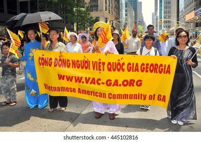 New York City - June 22, 2013:  Vietnamese marchers at the International Immigrants Foundation parade on Avenue of the Americas