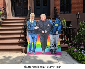 New York City, June 24, 2018 - Cardboard cutout of Robert Mueller arresting President Trump on display in the West Village in Manhattan.