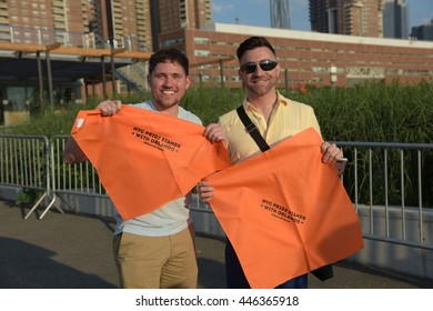 NEW YORK CITY -JUNE 24 2016:  NYC PRIDE weekend started off with a rally on Hudson Park Pier 26. Solidarity with Orlando themed kerchiefs passed out & tied