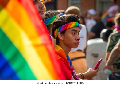 NEW YORK CITY - JUNE 25, 2017: Supporters wave rainbows flags on the sidelines of the annual Pride Parade as it passes through Greenwich Village.