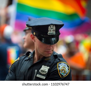 NEW YORK CITY - JUNE 25, 2017: Handsome NYPD Police officer provides security on the sidelines of the annual Pride Parade as it passes through Greenwich Village.