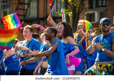 NEW YORK CITY - JUNE 25, 2017: Participants wave rainbow flags on a float in the annual Pride Parade as it passes through Greenwich Village.