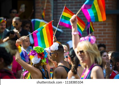 NEW YORK CITY - JUNE 25, 2017: Participants wave rainbows flags in the annual Pride Parade as it passes through Greenwich Village.