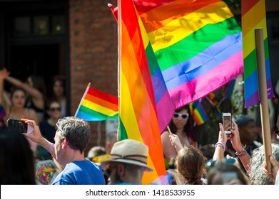 NEW YORK CITY - JUNE 25, 2017: Participants celebrate at the annual Gay Pride Parade waving rainbow flags as they pass through Greenwich Village.