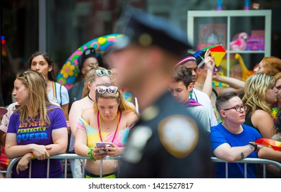 NEW YORK CITY - JUNE 25, 2017: NYPD police officers provides security on the sidelines of the annual Gay Pride Parade as it passes through Greenwich Village.