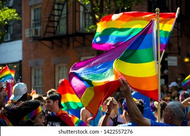 NEW YORK CITY - JUNE 25, 2017: Supporters wave rainbow flags in the annual gay Pride Parade as it passes through Greenwich Village.