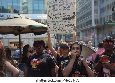 NEW YORK CITY - JUNE 25 2016: The 24th annual Dyke March NYC filled Fifth Avenue from Bryant Park to Washington Square Park. Members of NY Revolutionary Club