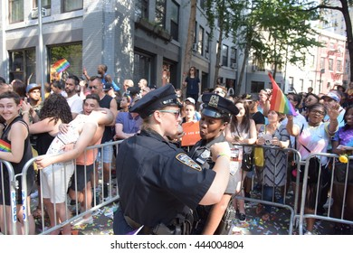 NEW YORK CITY - JUNE 26 2016: The 46th annual NYC Pride March featured over 350 contingents, marching from 36th Street to Christopher & Greenwich Sts. NYPD officers get into the spirit of things.
