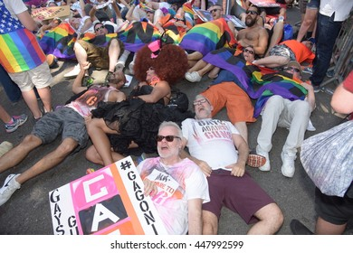 NEW YORK CITY - JUNE 26 2016: The 46th annual NYC Pride March featured over 350 contingents, marching from 36th Street to Christopher & Greenwich Sts. Gays Against Guns stage die in