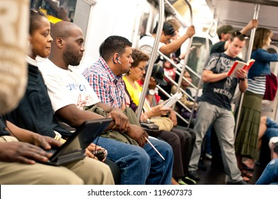 NEW YORK CITY - JUNE 27: Commuters in subway wagon on June 29, 2012 in NYC. The NYC Subway is one of the oldest and most extensive public transportation systems in the world, with 468 stations.