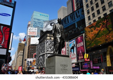 New York City - June 29, 2013:  Statue of Broadway's legendary showman George M. Cohan stands in the heart of Times Square surrounded by immense advertising billboards