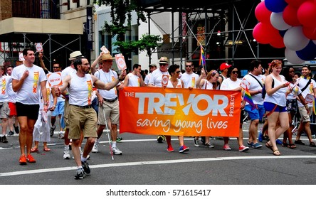 New York City - June 29, 2013:   Members of The Trevor Project with their orange banner marching in the 2013 Gay Pride Parade on Fifth Avenue