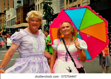 New York City - June 29, 2013:  Two men dressed in women's clothing marching in the annual Fifth Avenue Gay Pride Parade