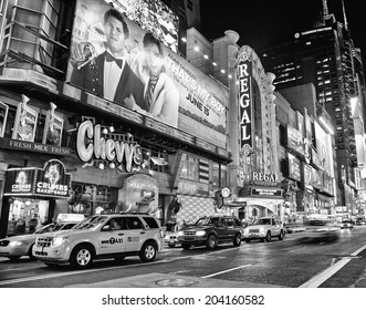 NEW YORK CITY - JUNE 3, 2012: Times Square in black and white, famous tourist attraction featured with Broadway Theaters and famous restaurant and store locations in New York City