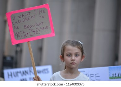 New York City, June 30, 2018 - Child holds a sign while participating in the Families Belong Together March for immigrants in Lower Manhattan.