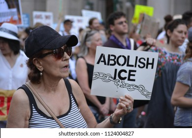 New York City, June 30, 2018 - People holding signs at the Families Belong Together March for immigrants in Lower Manhattan.