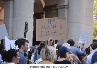 New York City, June 30, 2018 - Person holding a sign at the Families Belong Together March for immigrants in Lower Manhattan.