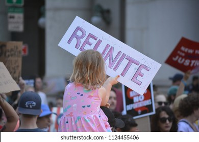 New York City, June 30, 2018 - Young girl holding a sign at the Families Belong Together March for Immigrants in Lower Manhattan.