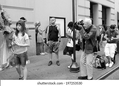 NEW YORK CITY - JUNE 30:  Legendary photographer Bill Cunningham documenting the NYC LGBT Gay Pride March in Manhattan on June 30, 2013. Photo in black and white.