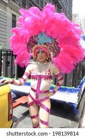 NEW YORK CITY - JUNE 30: Participant in the transgender float arrives in bright pink feathers for the annual NYC LGBT Gay Pride March in Manhattan on June 30, 2013.