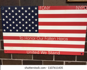 NEW YORK CITY - JUNE 4, 2018: 9/11 September 11 sign from NYPD FDNY to honor fallen heroes first responders united we stand.