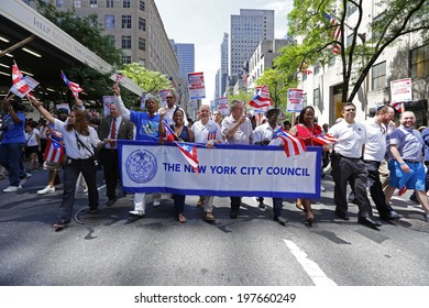 NEW YORK CITY - JUNE 8 2014: the 57th annual Puerto Rico Day Parade filled Fifth Avenue with 80,000 marchers & more than a million spectators. NYC City Council members marching behind banner