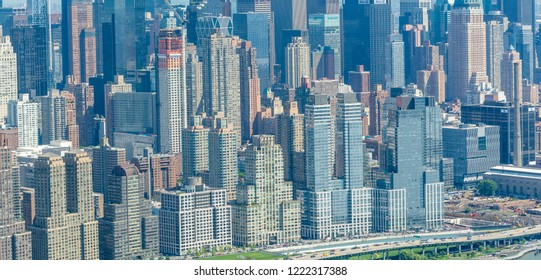 NEW YORK CITY - JUNE 9, 2013: Aerial view of Midtown skyscrapers. New York attracts 50 million tourists every year.