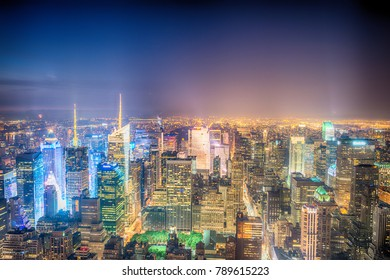 NEW YORK CITY - JUNE 9, 2013: Aerial night view of Midtown Manhattan. New York attracts 50 million tourists every year.