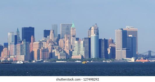 New York City lower Manhattan skyline with urban city skyline over river panorama view.