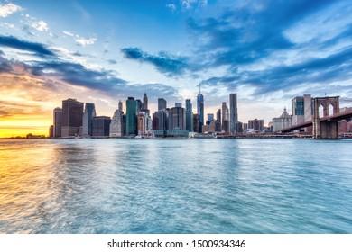 New York City Lower Manhattan with Brooklyn Bridge at Dusk, View from Brooklyn, New York