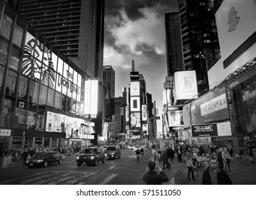 NEW YORK CITY, MANHATTAN, APR,24, 2015: Balck and white NYC Times Square lights screens buildings fashion boutiques led billboards New York architecture. Sightseeing holidays vacation tours trips