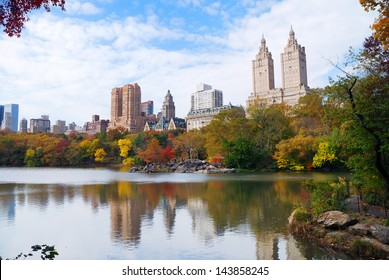 New York City Manhattan Central Park panorama in Autumn lake with skyscrapers and colorful trees with reflection.