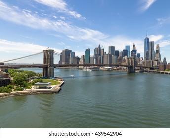 New York City Manhattan downtown buildings skyline Brooklyn Bridge
